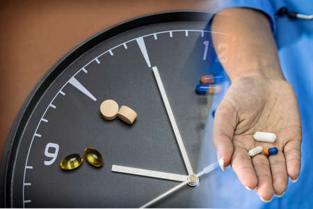 sleeping pills: concept for Healthcare And Medicine, a clock marks the time of taking medicines