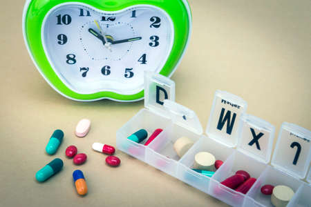 pillbox: some pills in a pillbox, daily medication treatment