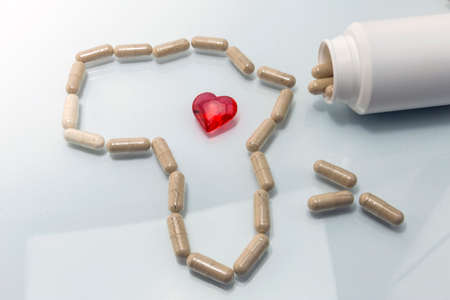 harmonization: Map Africa formed with capsules, red heart transparent concept of solidarity