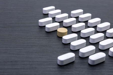 aligned: aligned white pills Stock Photo
