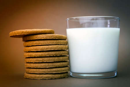 statics: Glass of milk and biscuits round Stock Photo