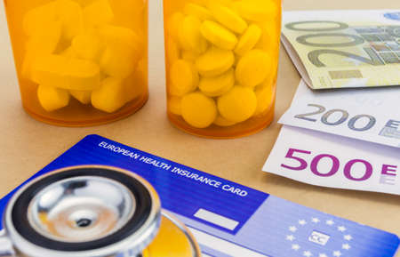 capsules up ticket euro and european health insurance card, concept of health copay Imagens