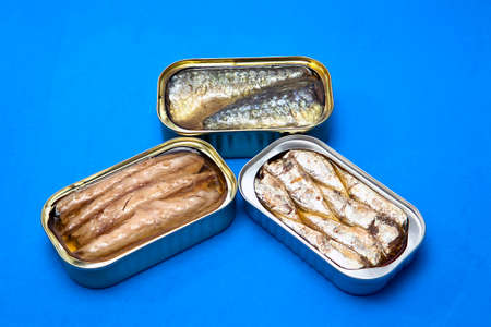 tinned goods: Tins of different sizes and opening