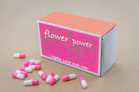 labelled: Open medicine packet labelled flower power to pink capsules, its a medical fake product Stock Photo