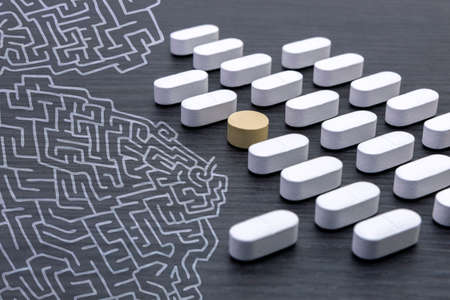 aligned: aligned white pills Stock Photo