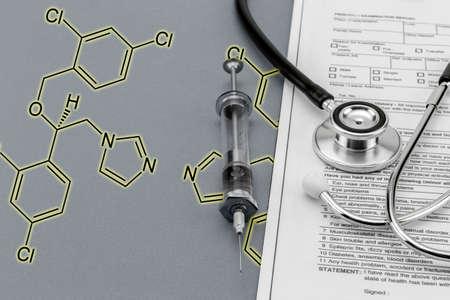 chemical formula: Test medication and stethoscope and old Syringe, Chemical formula