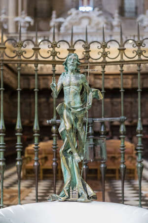 baptismal: JAEN, SPAIN - may 2016, 2: Triumphantly risen Christ that Crown the baptismal font in the Cathedral of Jaén, next to the choir and opposite the high altar