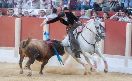 braveness: Ubeda, SPAIN - September 29, 2011: Noelia Mota, bullfighter on horseback spanish, Ubeda, Jaen, Spain