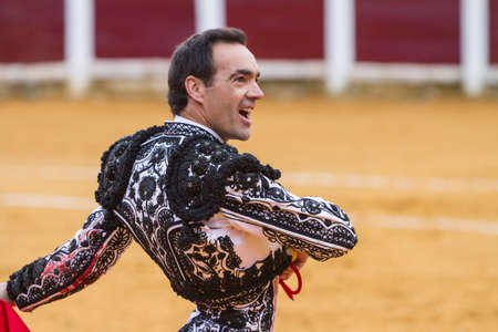 cid: Ubeda, SPAIN - October 4, 2010: The Spanish Bullfighter Manuel Jesus El Cid With a face of satisfaction after the job done during a bullfight, Ubeda, Jaen province, Andalusia, Spain