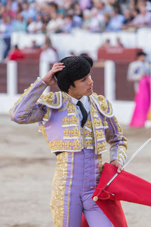 bullfighter: Linares, SPAIN - August 28 2014: Spainish bullfighter Sebastian Castella taking the cap from him to ask for permission to the presidency in the change of task in the bullring of Linares,  Jaen province, Spain Editorial