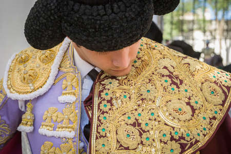 Baeza, SPAIN - August 15 2009: Spainish bullfighter Sebastian Castella putting itself the walk cape in the alley before going out to bullfight, typical and very ancient tradition in Baeza,  Jaen province, Spain Editorial