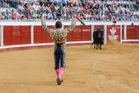david fandila: Pozoblanco, Spain - September 23, 2011: The Spanish Bullfighter David Fandila El Fandi with flags in each hand, classic of the taurine art movement in the Bullring of Linares, Spain