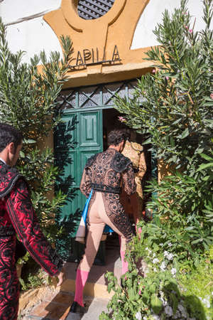 Linares, Spain - August 28, 2014: The Spanish Bullfighter enter chapel before starting bullfight, tradition ancestral and religion in the world of bullfighting, rite typical Spanish in Bullring of Linares, Spain Editorial