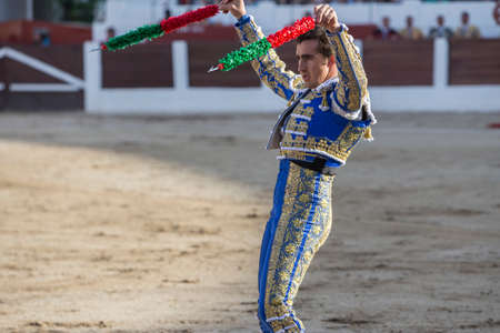 david fandila: Linares, Spain - August 28, 2014: The Spanish Bullfighter David Fandila El Fandi with flags in each hand, classic of the taurine art movement in the Bullring of Linares, Spain