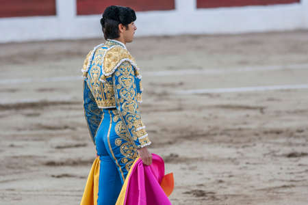 Linares, SPAIN - August 28 2011: The Spanish Bullfighter Miguel Angel Perera bullfighting with the crutch in the Bullring of Linares, Spain