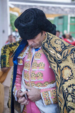 corrida de toros: Linares, SPAIN - August 29 2014: Spainish bullfighter Jose Tomas putting itself the walk cape in the alley before going out to bullfight, typical and very ancient tradition in Linares,  Jaen province, Spain