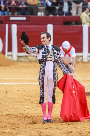 cid: Pozoblanco, Spain - September 23, 2011: The Spanish Bullfighter El Cid greeting the public with its cap in the hand in gratitude to its bullfight in the Bullring of Pozoblanco, Spain Editorial