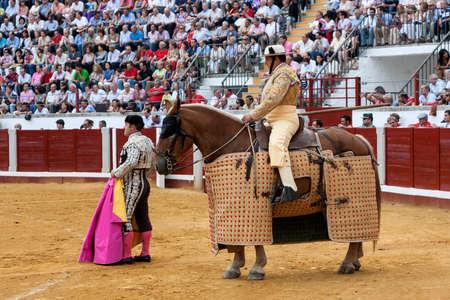weaken: Pozoblanco, Spain - September 23, 2011: Picador bullfighter, lancer whose job it is to weaken bulls neck muscles, in the bullring fo Pozoblanco, Cordoba province, Spain