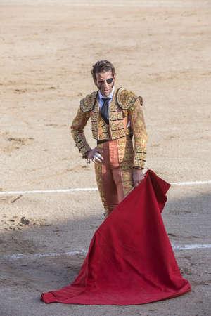 bullfighting: Linares, Spain - August 28, 2014: The Spanish Bullfighter Juan jose Padilla bullfighting with the crutch in the Bullring of Linares, Spain