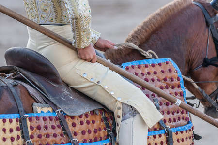 weaken: Linares, SPAIN - August 28 2011: Picador bullfighter, lancer whose job it is to weaken bulls neck muscles, in the bullring for Linares, Spain Editorial
