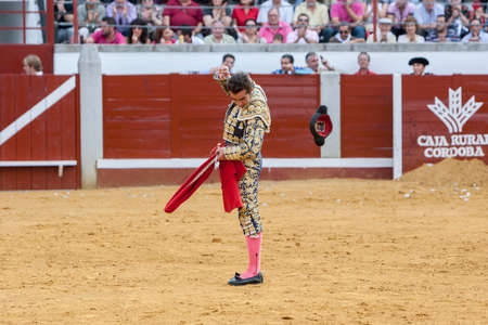el fandi: Pozoblanco, Spain - September 23, 2011: The Spanish Bullfighter David Fandila El Fandi Launches Its montera traditionally at the air to be lucky in the bullfight in the Bullring of Pozoblanco, Spain Editorial