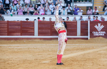 padilla: Pozoblanco, Spain - September 24, 2010: The Spanish Bullfighter Juan Jose Padilla remember with your eyes closed to master Paquirri with his arm raised at the 20th anniversary of his death in the Bullring of Pozoblanco, Spain