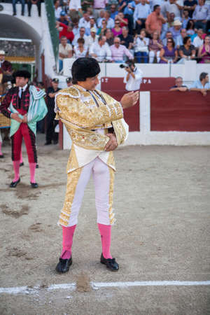 initiating: Linares, SPAIN - August 29 2014: The Spanish Bullfighter Curro Diaz initiating the paseíllo in the bullring in Linares, Jaen province, Spain Editorial