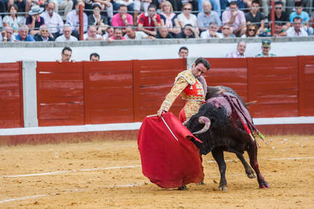 bullring: Pozoblanco, Spain - September 23, 2011: The Spanish Bullfighter Enrique Ponce bullfighting with the crutch in the Bullring of Pozoblanco, Spain Editorial