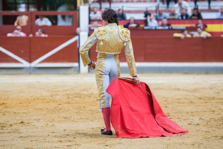 Jaen, SPAIN - October 17, 2008:  The Spanish Bullfighter Curro Diaz bullfighting with the crutch in the Bullring of Jaen, Spain Editorial