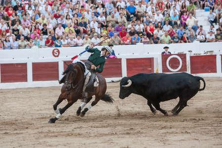 capote: Linares, SPAIN- august 31, 2011: Spanish bullfighter on horseback Diego Ventura bullfighting on horseback, in Linares, Spain