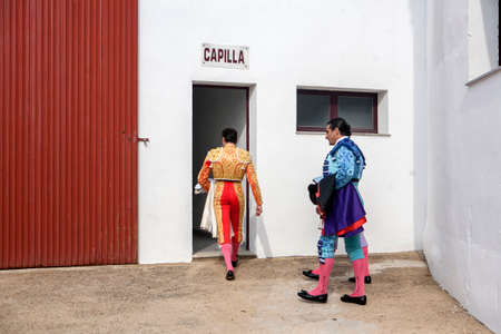 bullfighters: Pozoblanco, Spain - September 23, 2011: The Spanish Bullfighters enter chapel before starting bullfight, tradition ancestral and religion in the world of bullfighting, rite typical Spanish in Bullring of Pozoblanco, Spain Editorial