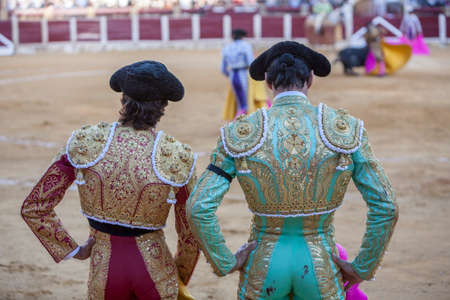 bullfighters: Ubeda, SPAIN - september 29, 2010: Spanish Bullfighters looking bullfighting, the Bullfighter on the left dressed in suit of lights of colors red and gold and the right color pistachio and gold in Ubeda, Jaen provincia, Andalusia, Spain Editorial