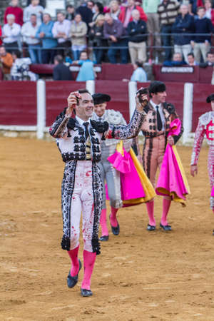 cid: Ubeda, SPAIN - October 4, 2010: The spanish bullfighter Manuel Jesus El Cid  to the turning of honour with an ear in his hand in the bullring of Ubeda, Spain