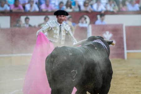 Pozoblanco, SPAIN, September 5, 2010: The Spanish Bullfighter bullfighting with the crutch in the Bullring of Pozoblanco, Spain Editorial