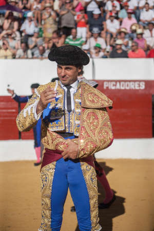 Sabiote, SPAIN, September 9, 2011: The Spanish Bullfighter Francico Rivera bullfighting with the crutch in the Bullring of Sabiote, Spain