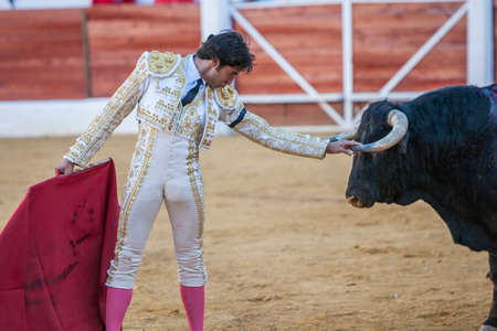 bullfight: Jaen, SPAIN - September 9, 2011: The Spanish Bullfighter Curro Diaz greeting the public with its cap in the hand in gratitude to its bullfight in the Bullring of Jaen, Spain