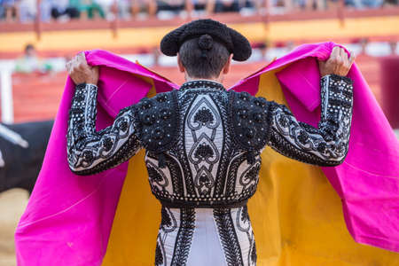 Sabiote, Spain - August 23, 2014: The Spanish Bullfighter bullfighting with the crutch in the Bullring of Sabiote, Spain