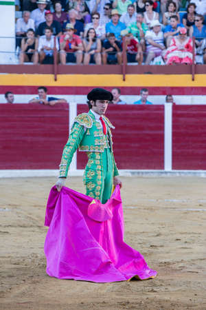Sabiote, Spain - August 23, 2014: The Spanish Bullfighter Adrian de Torres bullfighting with the crutch in the Bullring of Sabiote, Spain Editorial