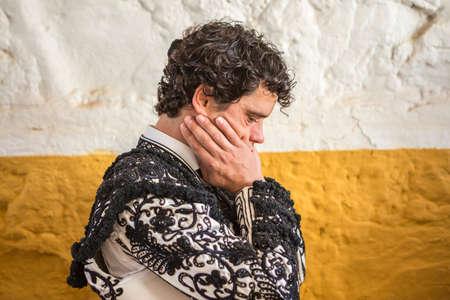 corrida de toros: And�jar, ESPA�A - 7 de septiembre de 2014: torero Miguel Abellan Spainish momentos totalmente centrado antes de salir a luchar en la plaza de toros de And�jar, Espa�a