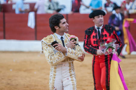 toros bravos: Sabiote, SPAIN - Sptember 9, 2011: The Spanish Bullfighter Cayetano Rivera greeting the public with its cap in the hand in gratitude to its bullfight in the Bullring of Sabiote, Spain Editorial