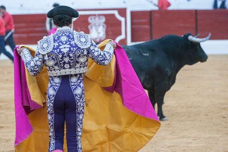 bullfighting: Sabiote, SPAIN, September 9, 2011: The Spanish Bullfighter bullfighting with the crutch in the Bullring of Sabiote, Spain