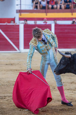 Sabiote, Spain - August 23, 2014: The Spanish Bullfighter Manuel Escribano bullfighting with the crutch in the Bullring of Sabiote, Spain