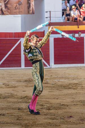 padilla: Sabiote, Spain - August 23, 2014: The Spanish Bullfighter Juan Jose Padilla putting flags during a bullfight in the Bullring of Sabiote, Spain