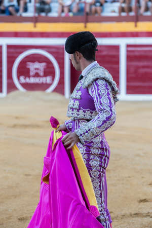 capote: Sabiote, Spain - August 23, 2014: Bullfighter with the capote or cape, Spain, Sabiote, Spain