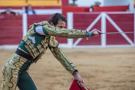 padilla: Sabiote, SPAIN - August 23, 2014: Spanish bullfighter Juan Jose padilla with sword in hand right looks to concentrate bull ready to kill in the Bullring of Sabiote,  Spain