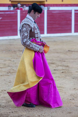 fighting bulls: Sabiote, Spain - August 23, 2014: Bullfighter with the capote or cape, Spain, Sabiote, Spain