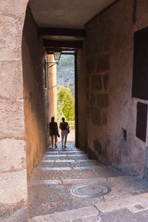 cuenca: Tourists walk along the alleys close to the cathedral of Cuenca to the evening, Cuenca, Spain Editorial