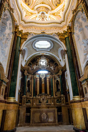 CUENCA, SPAIN - August 24, 2016: Inside the Cathedral of Cuenca, the bureau of the altar and its front panel are of jasper, and the altarpiece of polychrome wood with a reproduction on a column of the Virgen del Pilar in Zaragoza, Cuenca, Patrimony of the