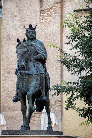 crucifixes: Sculpture of King Alfonso VIII in the Old Town of the city, work of the artist of Cuenca Javier Barrios, Cuenca, Spain