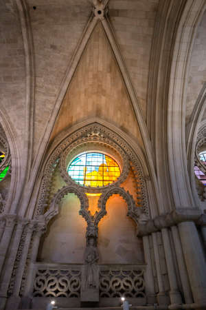 CUENCA, SPAIN - August 24, 2016: Detail of stained glass window and Nave Ceiling in the interior of the Cathedral of Our Lady of Grace and Saint Julian of Cuenca. Castilla-La Mancha, Spain